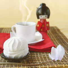 White day. Zephyr with the cup of coffee and doll in the Japanes