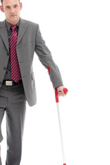 Disabled Businessman On Crutches