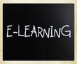 """""""E-learning"""" handwritten with white chalk on a blackboard"""