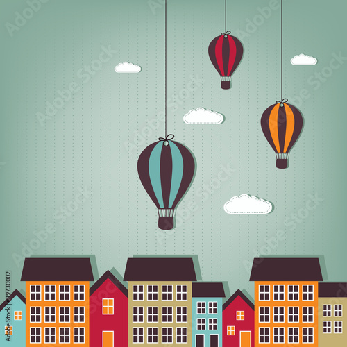 hot air balloons flying over town