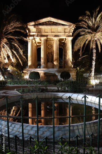 Valletta: night view of greek temple dedicated to sir Alexander Ball in Lower Barracca Gardens - Malta