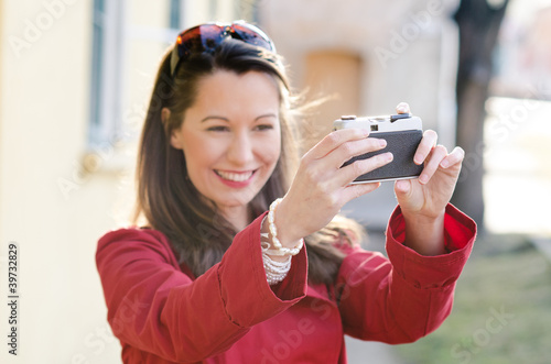 Beautiful smiling girl with camera