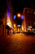 Narrow street in old Riga by night in Christmas time
