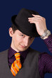Young man with hat and orange necktie
