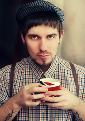Englishman with a cup