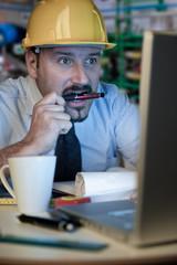 man with helmet at work
