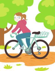 donna in bicicletta nel parco