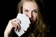 The beautiful girl with playing card