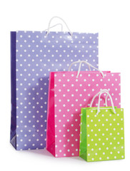 Bright gift bags isolated on white