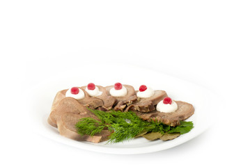 Tasty boiled beef tongue with dill on a white background