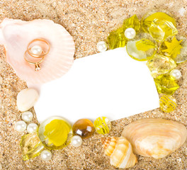two worn golden rings and shells, crystals
