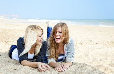 Two girls at outdoor near sea.