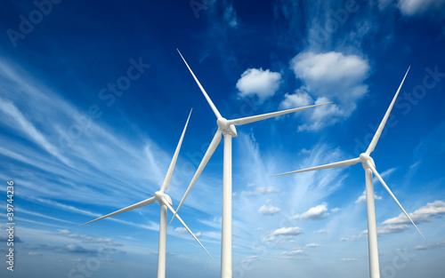 Leinwandbild Motiv Wind generator turbines in sky