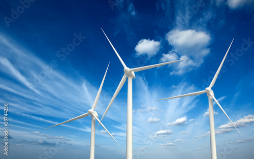 Leinwanddruck Bild Wind generator turbines in sky