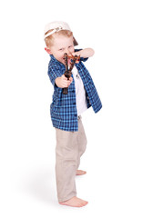 Expressive emotional little boy with slingshot