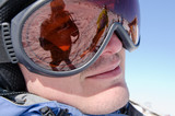 Male skier wearing ski glasses