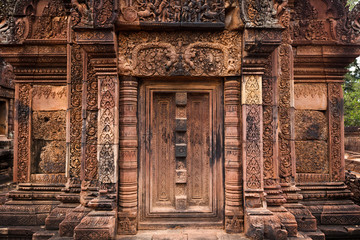 Intricate carved door of Angkor temple