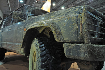Mud-covered Sport Utility Vehicle