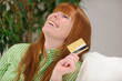 young woman with credit card laughing