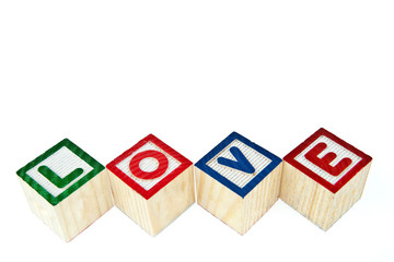 Love by block toy isolated on white background