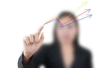 Business lady pushing up graph on the whiteboard.