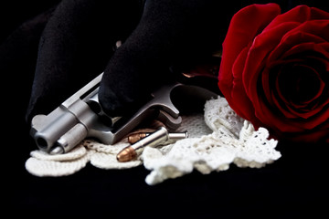 Handgun with rose