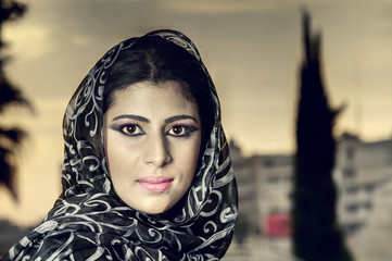 beautiful arabian lady wearing traditional islamic outfit