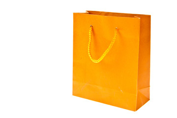 Orange paper bag isolated on white background
