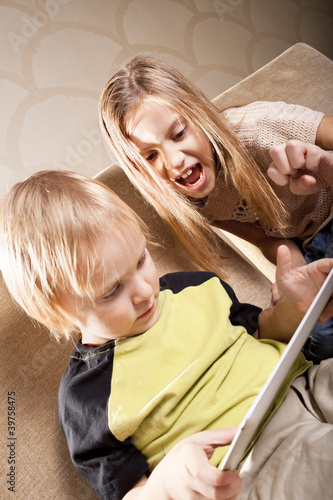 girl and boy with tablet computer