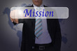 Hand of Business Man Pressing or Pushing Mission button