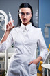 Attractive female doctor with medical syringe