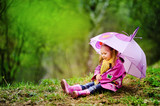 Fototapety smiling little girl with umbrella in the park