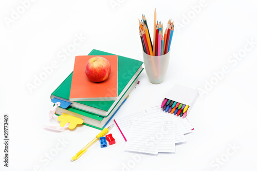 School supplies: books, notebook, pens, pencils, glasses, an app