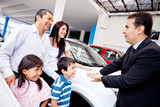 Family with a car salesman