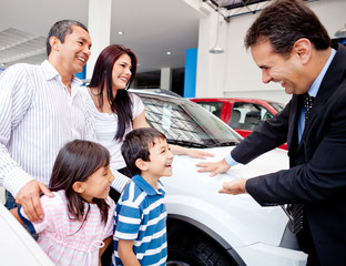 Family buying a new car