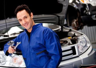 Male mechanic smiling
