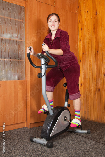 girl  exercising on exercise bike