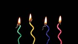 Candles on a Birthday cake burning down, time lapse, reversing