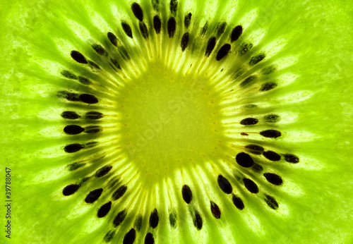 Plexiglas Plakjes fruit Fresh Kiwi background / SuperMacro / back lit