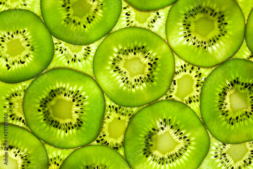 Foto Spatwand Plakjes fruit Fresh Kiwi pattern / background / back lit