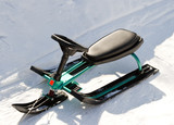 Green Children's sled (snowmobile, snowbicycle).