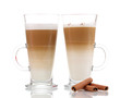 Fragrant сoffee latte in glass cups and cinnamon isolated
