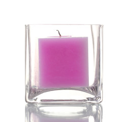 Beautiful purple candle isolated on white