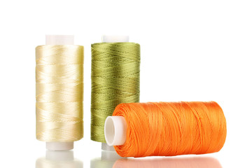 Three bobbin thread isolated on white