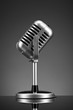Retro microphone on grey
