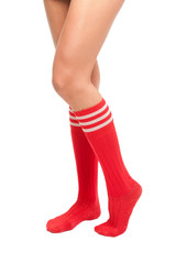 a close up of female legs with soccer socks