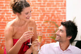 Couple drinking champagne in restaurant