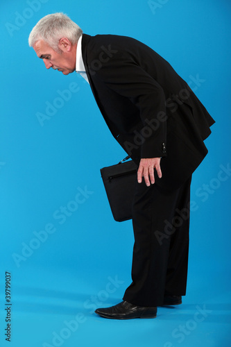 Tired businessman stooping over