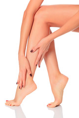 Well-groomed female legs after depilation procedure