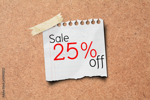 sale off price tag on paper post on wooden board.